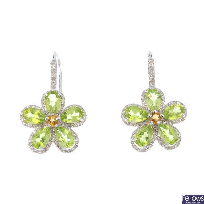 A pair of citrine, peridot and diamond earrings.