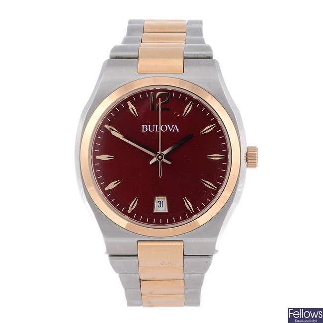 BULOVA - a lady's bi-colour bracelet watch.