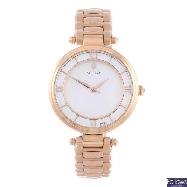 BULOVA - a lady's rose gold plated bracelet watch.