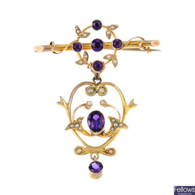 An early 20th century gold amethyst and split pearl brooch.