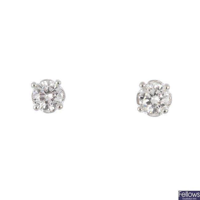 A pair of brilliant-cut diamond earrings.
