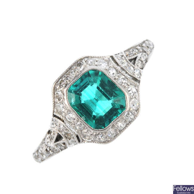 An Art Deco synthetic emerald and diamond dress ring.