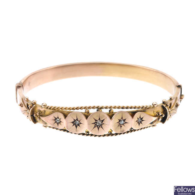 An Edwardian 9ct gold diamond hinged bangle.