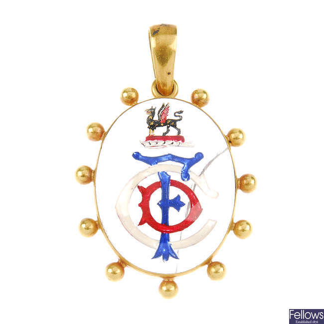 A monogram cabochon pendant.