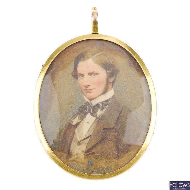 A mid Victorian portrait memorial pendant.