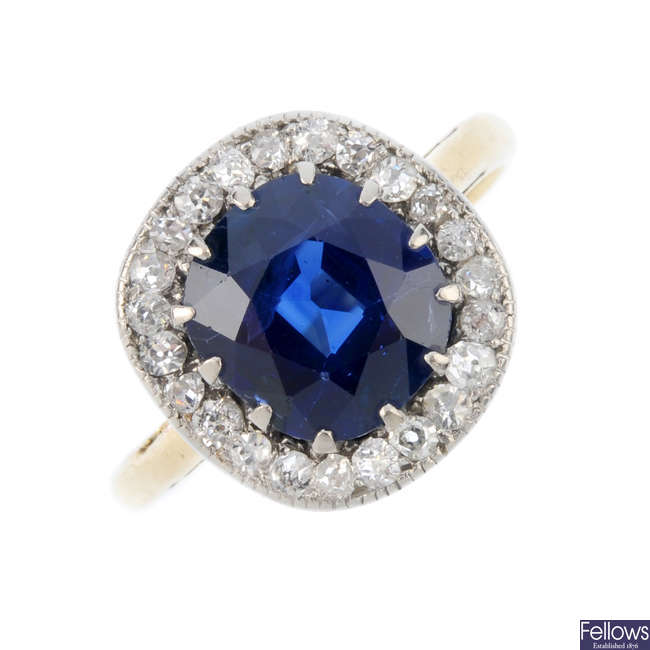 An early 20th century sapphire and diamond cluster ring.