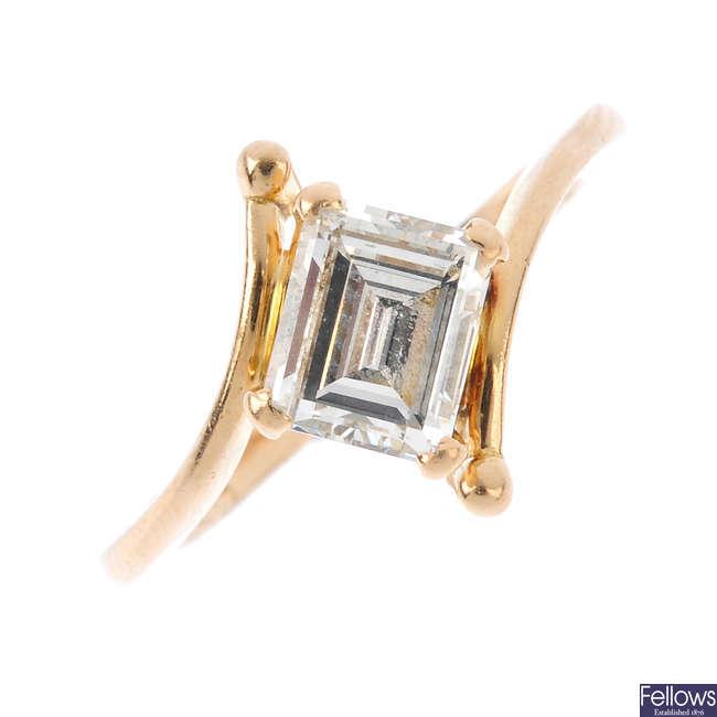 A diamond single-stone crossover ring.
