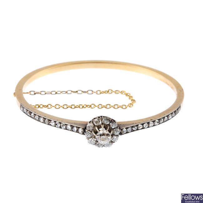A late Victorian 18ct gold diamond hinged bangle.