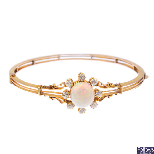A late Victorian gold, opal and diamond hinged bangle.