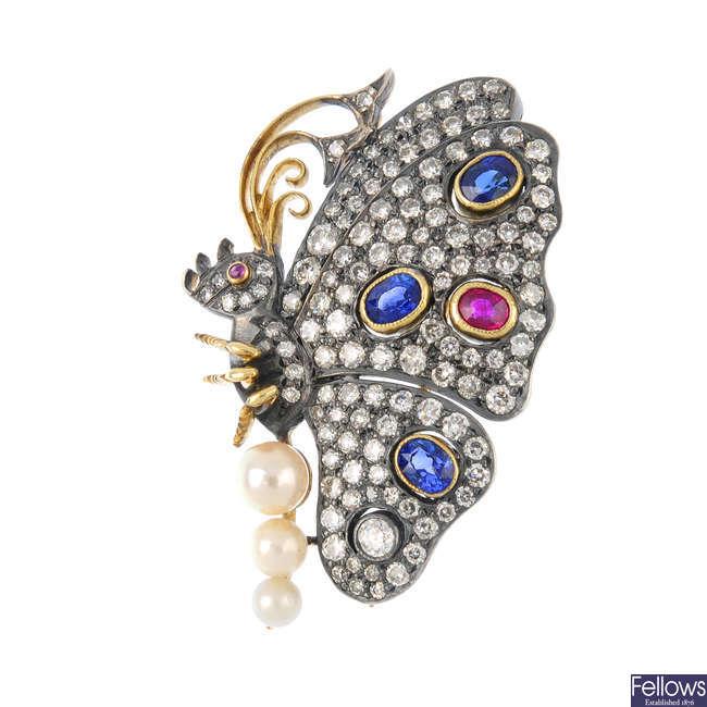 A diamond and gem-set brooch.