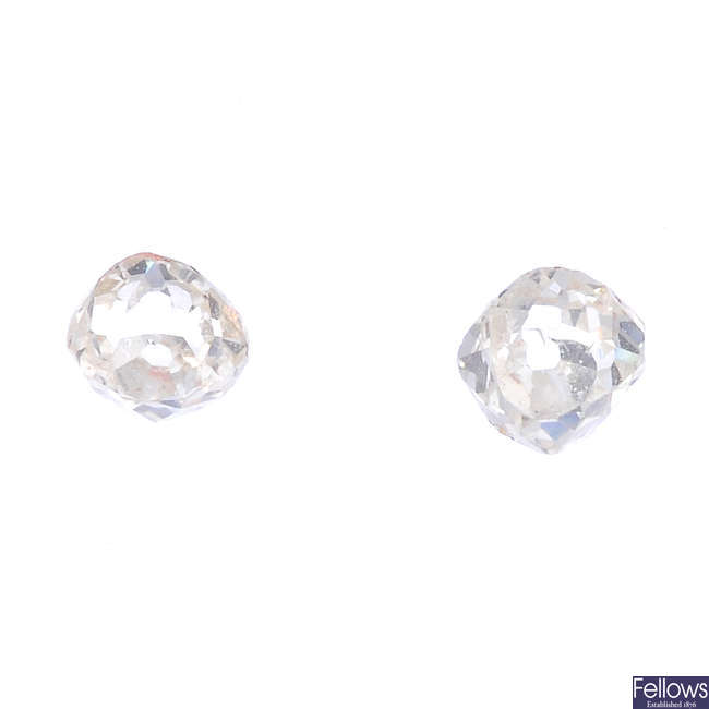 Two old-cut diamonds, weighing 0.21 and 0.23ct.