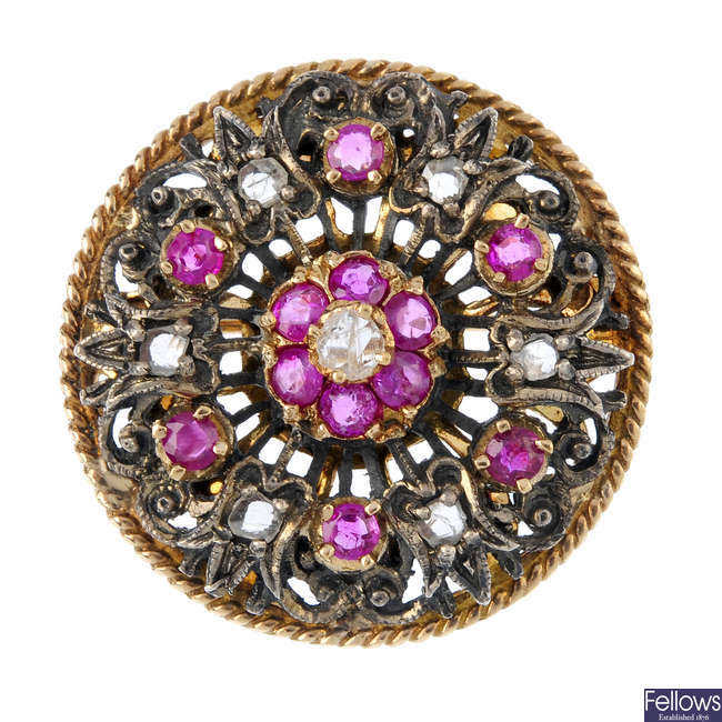 A diamond and ruby floral brooch.