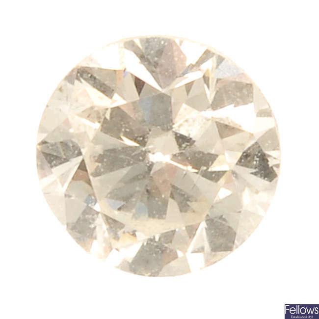 A brilliant-cut diamond, weighing 0.32ct.