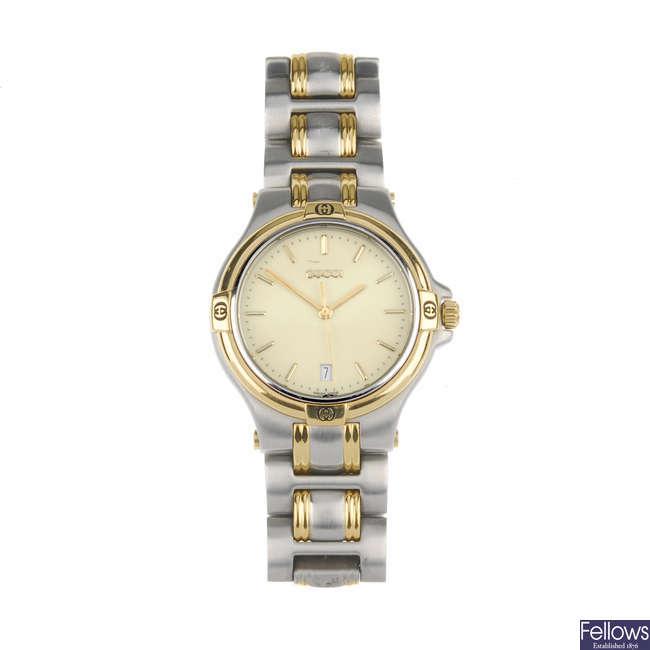 GUCCI - a gentleman's bi-colour 9040M bracelet watch with a Gucci 122.5 bracelet watch.