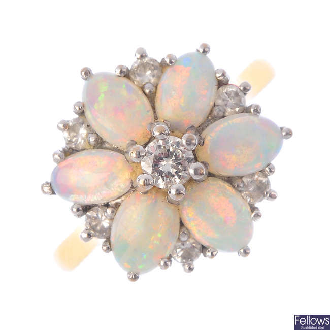 An 18ct gold opal and diamond dress ring.