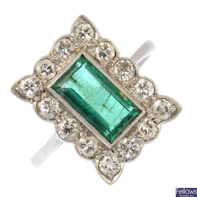 An early 20th century emerald and diamond cluster ring.