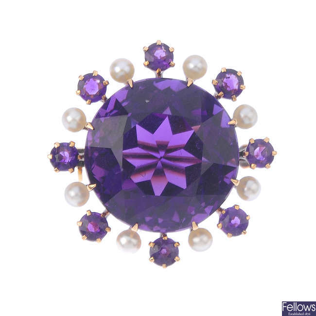 An amethyst and seed pearl brooch.