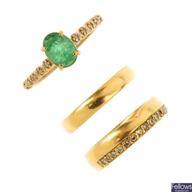 Two 18ct gold rings and a 9ct gold gem-set ring.