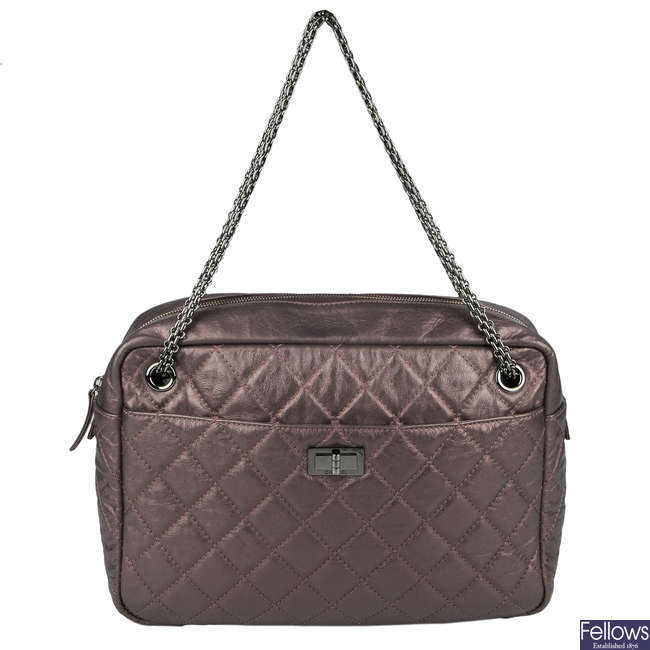 CHANEL - a Large Metallic Reissue quilted camera handbag.