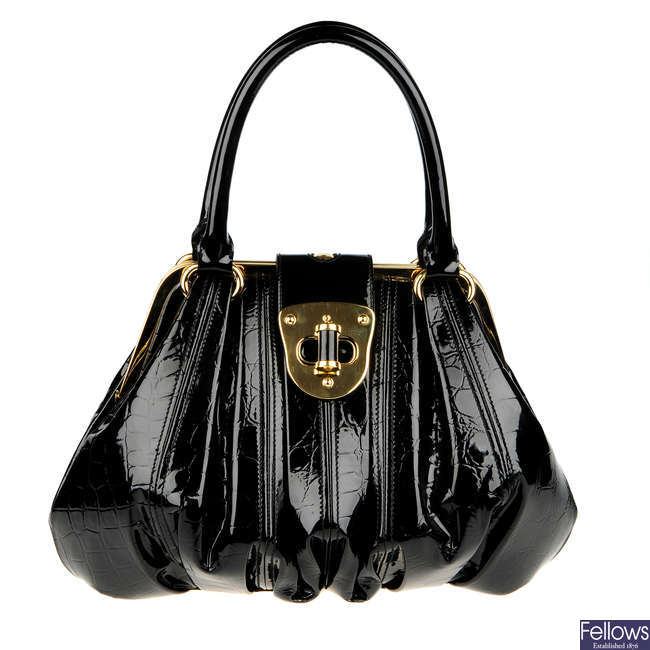 ALEXANDER MCQUEEN - a patent leather Elvie handbag.
