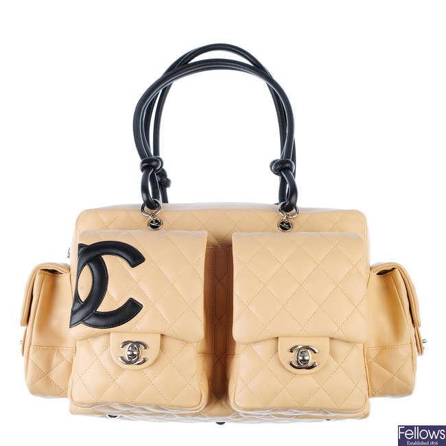 CHANEL - a beige Ligne Cambon reporter handbag.