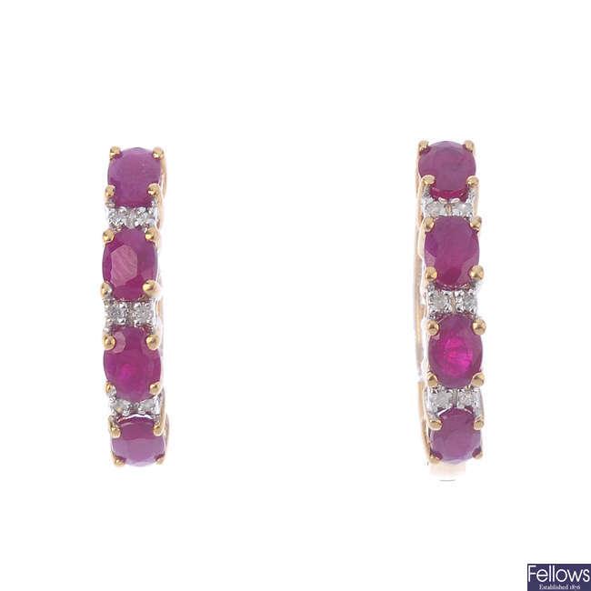 A pair of 9ct gold ruby and diamond hoop earrings.