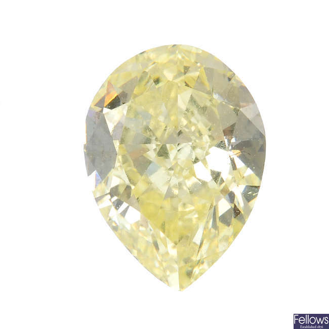 A pear-shape 'yellow' diamond, weighing 1.02cts.
