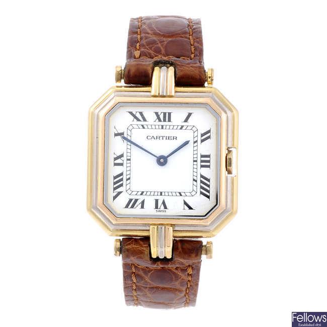 CARTIER - a yellow metal wrist watch.