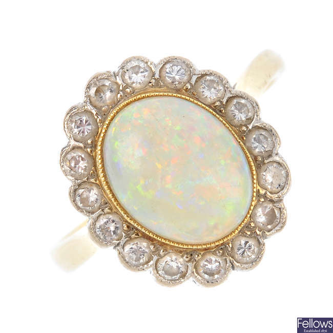 An 18ct gold diamond and opal cluster ring.