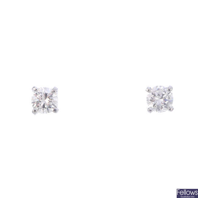 A pair of brilliant-cut diamond single-stone stud earrings.