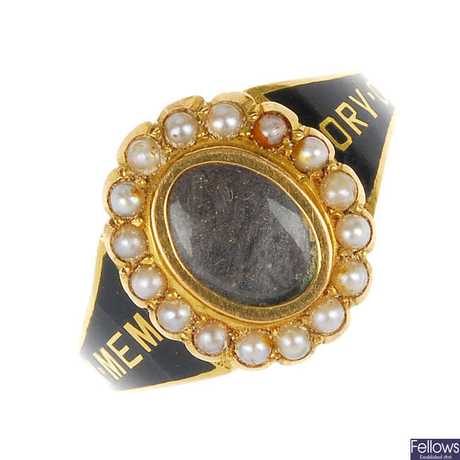An 18ct gold early 20th century enamel and split pearl memorial ring.