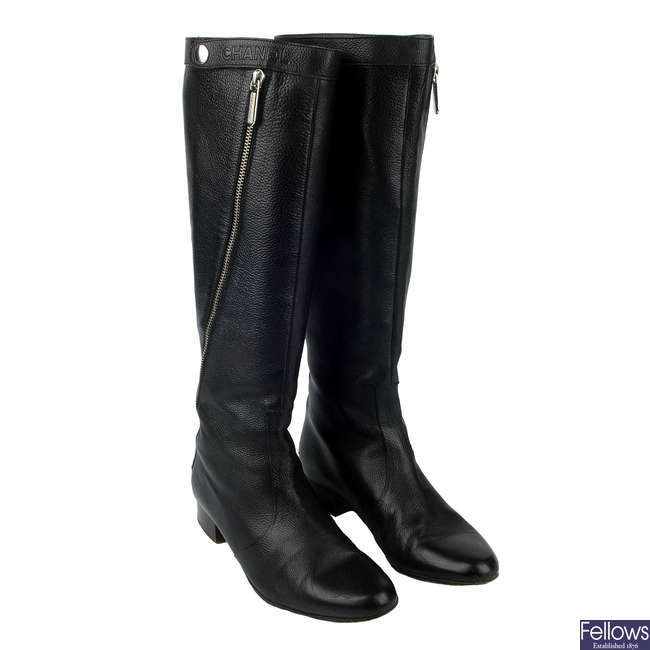 CHANEL - a pair of black leather Zip-Twist knee-high boots.