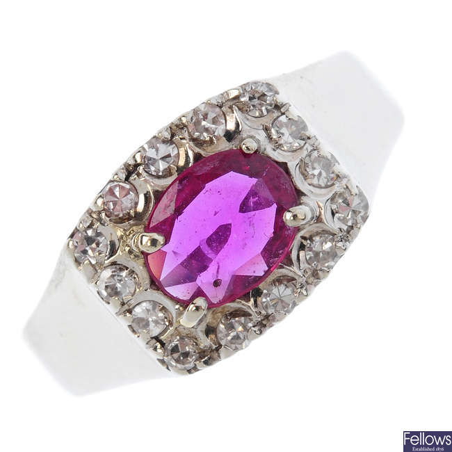 A mid 20th century ruby and diamond cluster ring.