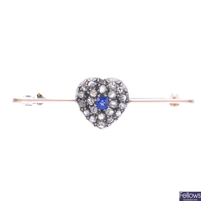 A sapphire and diamond brooch.