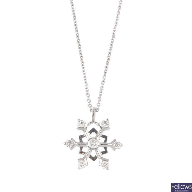 A diamond snowflake pendant, with 18ct gold chain.