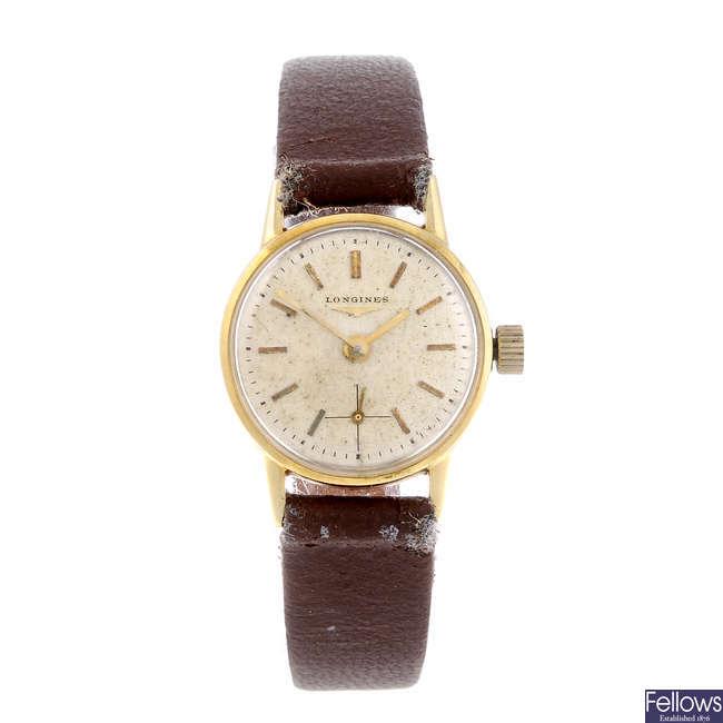 LONGINES - a lady's yellow metal wrist watch.