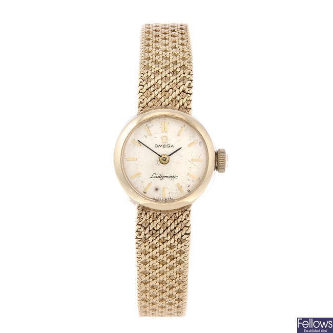 OMEGA - a lady's 9ct yellow gold Ladymatic bracelet watch.