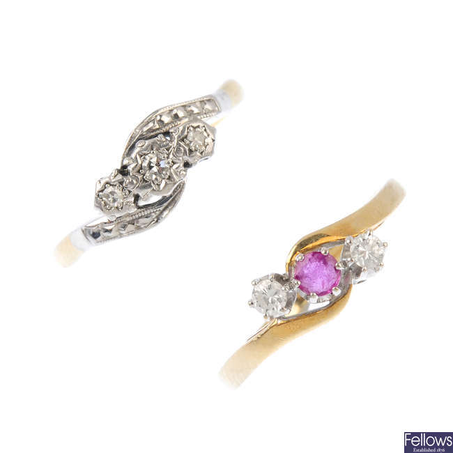 Two diamond and gem-set crossover rings.