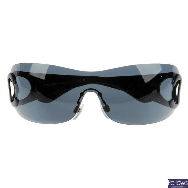 CHANEL - a pair of wide rimless sunglasses.