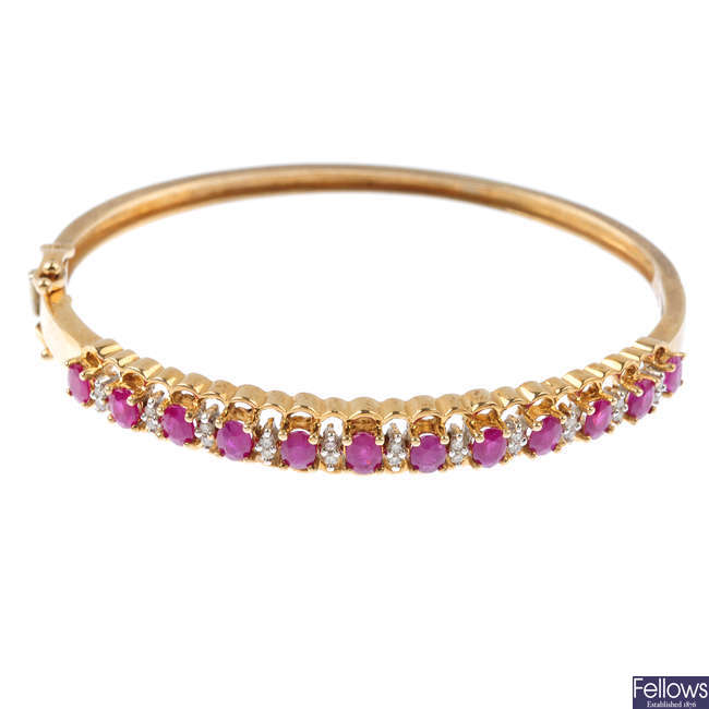 A 9ct gold ruby and diamond hinged bangle.