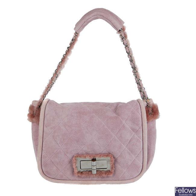 CHANEL - a pink Reissue Shearling Flap handbag.