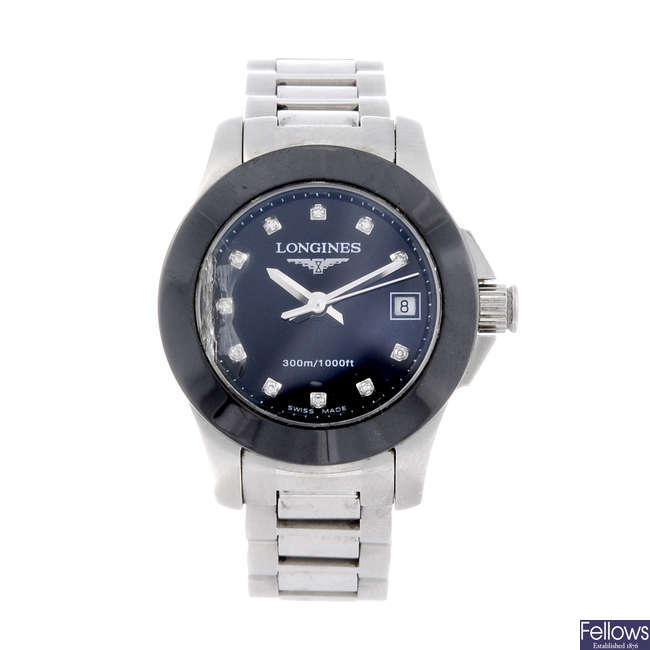LONGINES - a lady's bi-material Conquest bracelet watch.