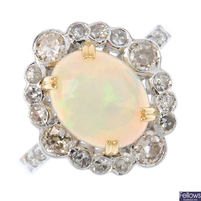 An opal and diamond cluster ring.