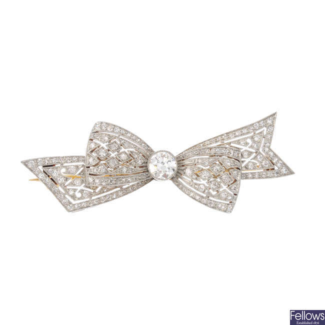 A platinum and 18ct gold diamond bow brooch.