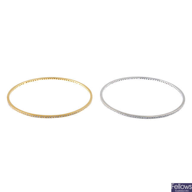Two 18ct gold diamond bangles.