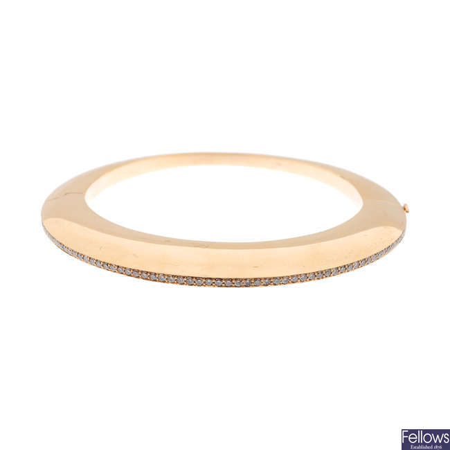 GEORG JENSEN - an 18ct gold diamond 'Dune' hinged bangle.