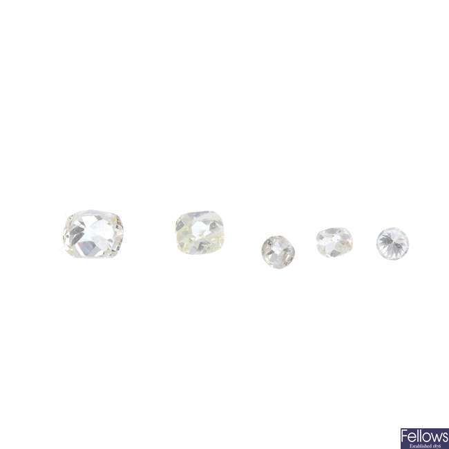 Five old-cut diamonds.