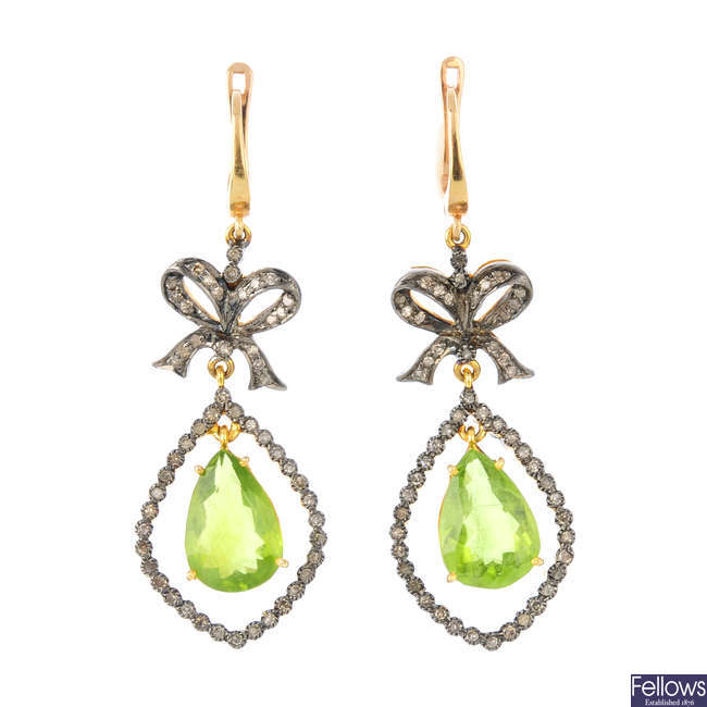 A pair of peridot and diamond earrings.
