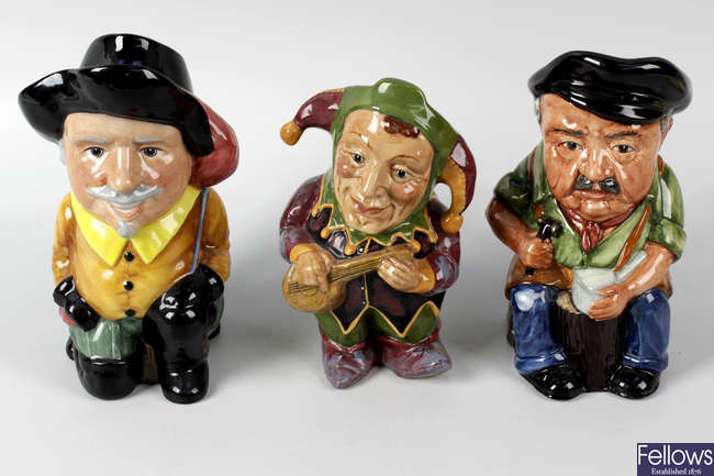 A large group of Artone character jugs and teapots.