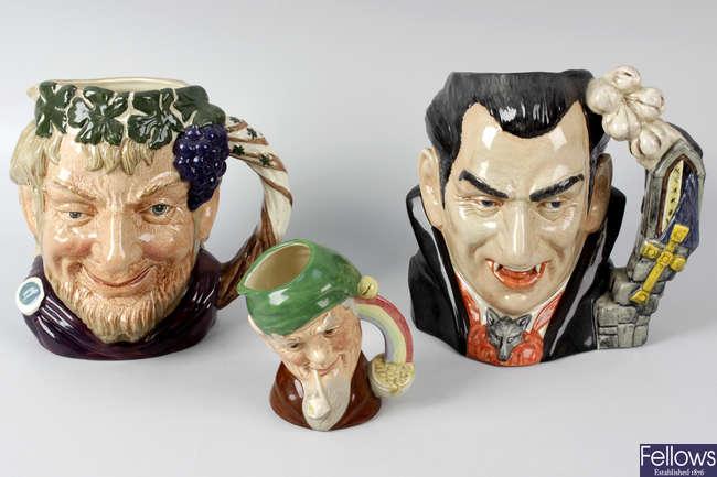 A group of seven Royal Doulton character jugs.